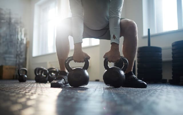 Lifting Kettle Bell Muscle